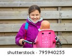 girl riding a bicycle with a... | Shutterstock . vector #795940255