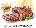 Small photo of Roast pork with prunes on blurred background, close-up.