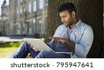 multinational young man sitting ... | Shutterstock . vector #795947641