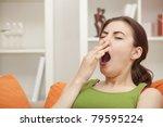 yawning woman sitting on sofa... | Shutterstock . vector #79595224