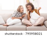 girl overhearing her girlfriend ... | Shutterstock . vector #795958021