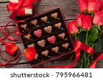 Stock photo valentines day greeting card with red roses and heart shaped chocolate on wooden background top 795966481