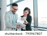 two young business people... | Shutterstock . vector #795967807
