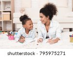 mom and little girl lie on the... | Shutterstock . vector #795975271