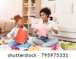 mom and a little girl make... | Shutterstock . vector #795975331
