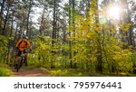 cyclist in orange riding the... | Shutterstock . vector #795976441
