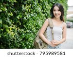 smiling woman on green leaf... | Shutterstock . vector #795989581