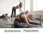 young female yoga instructor... | Shutterstock . vector #796025491