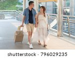 young asian couple walking with ... | Shutterstock . vector #796029235