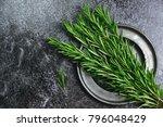 fresh rosemary herb on the dark ...   Shutterstock . vector #796048429