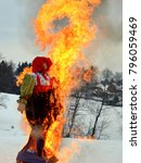 Small photo of Burning effigies Straw Maslenitsa on Sunday of pancake week before lent in Russia. Traditional Slavic celebration of seeing off winter and approaching spring.