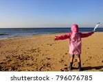 girl in raincoat and boots with ...   Shutterstock . vector #796076785