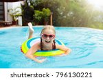 child with goggles in swimming... | Shutterstock . vector #796130221