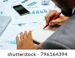 businessman with red pen... | Shutterstock . vector #796164394