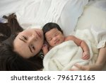 newborn baby in a tender... | Shutterstock . vector #796171165