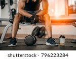 muscular man at gym taking a... | Shutterstock . vector #796223284