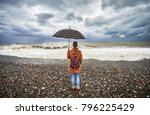 woman with umbrella and...   Shutterstock . vector #796225429