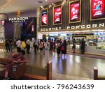 Small photo of BANGKOK - DECEMBER 2017: Unidentified people buy food at a snack bar of Paragon Cineplex in the Siam Paragon shopping mall. With 16 screens and 5,000 seats, it is Thailands largest movie theater.