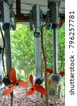 Small photo of A row of motor driven propellers of Ferries suspended on a support.