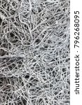 Small photo of closeup of entangled galvanised wire mesh