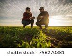 young farmers examing planted... | Shutterstock . vector #796270381