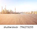 empty wood floor with city... | Shutterstock . vector #796273255