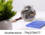 coin in the glass jar. saving... | Shutterstock . vector #796378477