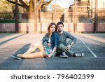 young couple in love posing on... | Shutterstock . vector #796402399