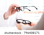 optician giving new glasses to... | Shutterstock . vector #796408171
