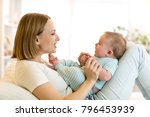 mother and his baby son smiling ... | Shutterstock . vector #796453939