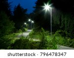 night empty road with modern LED street lights - stock photo