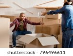 african american couple packing ... | Shutterstock . vector #796496611