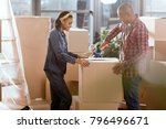 african american couple packing ... | Shutterstock . vector #796496671