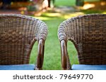 Two Bamboo Chairs In Garden