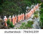 statues of monks on a rock in... | Shutterstock . vector #796541359