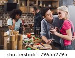 men hugging girl during party... | Shutterstock . vector #796552795