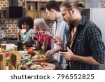 man looking at smartphone at... | Shutterstock . vector #796552825