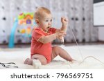 funny baby boy pulling cables... | Shutterstock . vector #796569751
