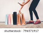 woman wear black jeans holding... | Shutterstock . vector #796571917
