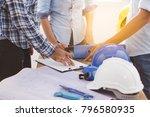 builder team meeting and... | Shutterstock . vector #796580935