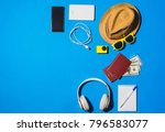 random travel objects on blue... | Shutterstock . vector #796583077
