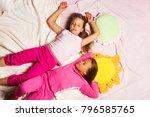 children with sleepy faces lie... | Shutterstock . vector #796585765