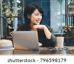 happy young asian woman working ... | Shutterstock . vector #796598179
