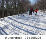 ladies snowshoeing on a groomed ... | Shutterstock . vector #796605205