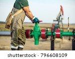 oil worker is turning valve on...   Shutterstock . vector #796608109