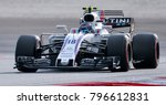 Small photo of SEPANG, MALAYSIA - SEPTEMBER 30, 2017 : Lance Stroll of Canada driving the (18) Williams Martini Racing on track during the Malaysia Formula One (F1) Grand Prix at Sepang International Circuit.