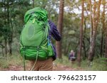 young man backpacker hiking in... | Shutterstock . vector #796623157