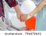 close up hands loving couple... | Shutterstock . vector #796670641