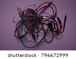 Small photo of electric wire, isolated on a lilac background. many colored wires. insecure
