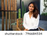 beautiful woman at home sitting ...   Shutterstock . vector #796684534